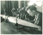 Engineering student measuring propeller in engineering laboratory, The University of Iowa, 1939