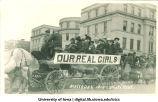 Wagon of women in Mecca Day parade on Washington Street, The University of Iowa, 1914