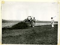 Farmers Using Auger