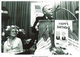 Mary Louise Smith watches Assemblyman Joseph M. Margiotta speak at Nassau county fund-raising dinner, Hauppauge, N. Y., June 19, 1975