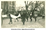 Soldiers marching in Mecca Day parade, The University of Iowa, 1920