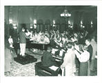 Singing Christmas carols in the Iowa Memorial Union, the University of Iowa, 1950s?