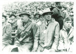 "R.S. Macy and Dr. ""Shorty"" Paul at a football game, The University of Iowa, 1950s"