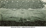 Marching band performing at football game, The University of iowa, 1940s?