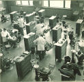 Dental students working with patients in a large clinic, The University of Iowa, 1940s