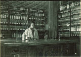 Student mixing drug in pharmacy laboratory, The University of Iowa, 1930s