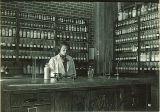 Student mixing drug in pharmacy laboratory, The University of Iowa, 1930s