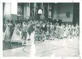 School children performing minuet, The University of Iowa elementary school, 1963 or 1964