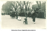 Marchers in costume for Mecca Day parade, The University of Iowa, 1921
