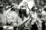 Saxophone player and drummer marching in the ISU Alumni Band at Homecoming, 1985