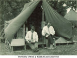 Men reading books outside tent at Camp Kellogg, The University of Iowa, 1926