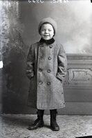 Boy smiling in winter coat