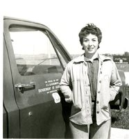 Woman Smiling in Front of SCS Truck