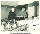 Men clearing away dishes at Centennial Dinner, Iowa Memorial Union, University of Iowa, February 25, 1947