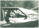 Mary Louise Smith in car, 1980s