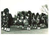 Scottish Highlanders standing in formation, The University of Iowa, 1930s