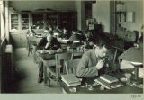 Students with microscopes in zoology laboratory, The University of Iowa, 1920s