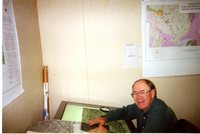 Man With Topographic Maps