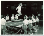 Jo Ann Juhl on a trampoline in Lucille Magnusson's gym class in Halsey Hall, The University of Iowa, 1950s