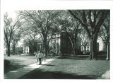 Students walking near Schaeffer Hall, the University of Iowa, 1962