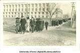 Crowd walking west down Washington St. with McLean Hall in background, The University of Iowa, 1910s