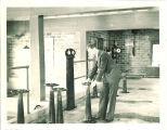 Graduate student operator Robert Hanlon washing a filter at waterworks, The University of Iowa, January 1936