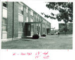 Woman and child outside Hawkeye Drive Apartments, the University of Iowa, 1960s?
