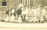 Grade 2 school children outside school, Tama, Iowa, 1909