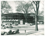 Cars parked near Main Library construction, the University of Iowa, between 1949 and 1951
