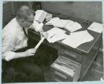 Researcher with slide rule