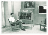 Man perusing new books in Main Library north lobby, the University of Iowa, 1955
