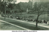 Crowd marching on Madison St. past Pentacrest, The University of Iowa, October 1, 1923