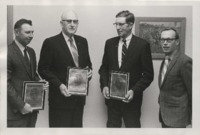 Men receiving Certificate of Merit Awards.