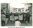 Peace march on Clinton St., Iowa City, Iowa, 1960s