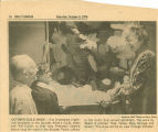 Newspaper picture and caption of Drewelowe at Boulder Public Library hanging a woman's painting, Oct. 9, 1976
