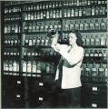 Pharmacy student pouring liquid pharmaceutical, The University of Iowa, 1940s