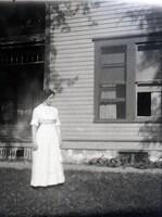 Woman by window on lawn