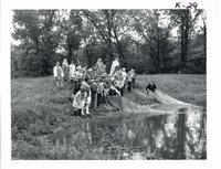 Preston fifth graders observing Harold Sullivan seining minnows from his farm pond, 1969