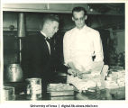 Waiter and chef preparing food for Centennial Dinner, Iowa Memorial Union, University of Iowa, February 25, 1947