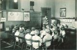 Teacher instructing children on traffic safety, The University of Iowa, 1925