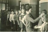 School nurse examining students, The University of Iowa elementary school, January 22, 1932