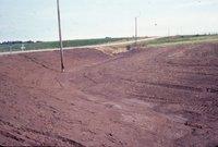 Muddy farmland by road