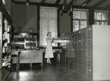 Dorothy Kehlenbeck looking at files, 1954