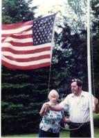 Hubert Dwight Hough raising the American Flag.