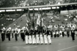Military color guard performing with the ISU Marching Band at Homecoming, 1985