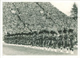 Line of Scottish Highlanders marching at Kinnick Stadium, The University of Iowa, 1960s