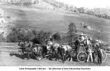 Team of four horses pulling a wagon of people toward the Gold Finch Mine, Mont., late 1890s or early 1900s