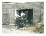 Men moving linograph machine, The University of Iowa, 1950s