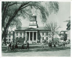 Students walking by Old Capitol, the University of Iowa, 1950s