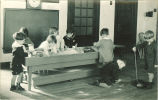 Children playing with sand in playroom, The University of Iowa, 1920s